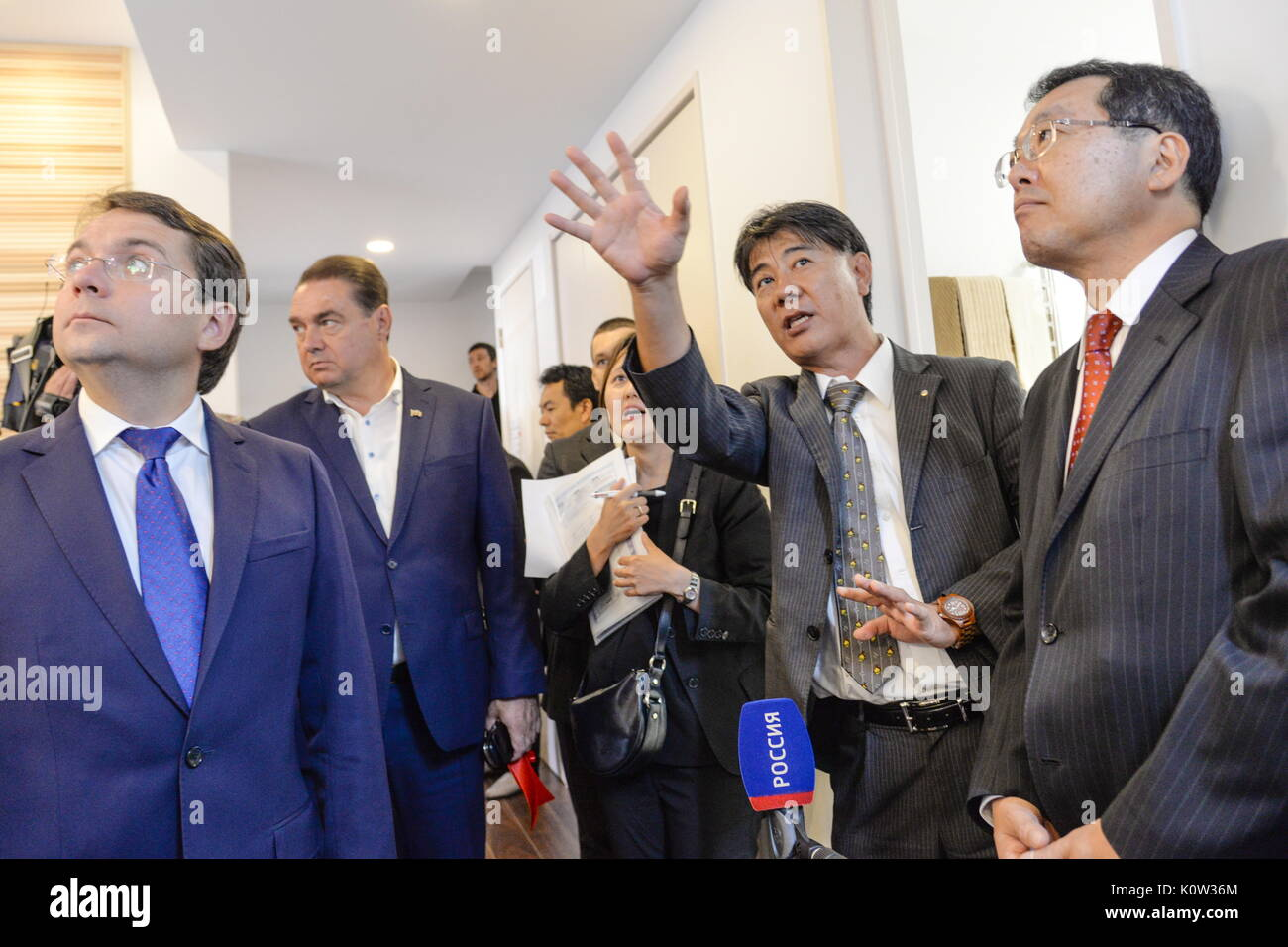 VORONEZH, RUSSIA - AUGUST 24, 2017: Russia's Deputy Construction, Housing and Utilities Minister Andrei Chibis (L) and Japan's Deputy Land, Infrastructure, Transport and Tourism Minister Koichi Yoshida (R) at the opening of the first Russian-Japanese two-storey smart home made of wood and eco-friendly materials. The house is equipped with energy management system, air quality monitors and temperature sensors. Kristina Brazhnikova/TASS - Stock Image