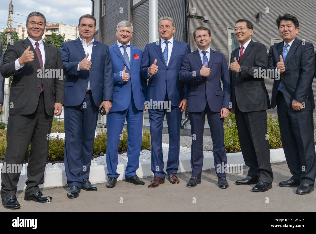 VORONEZH, RUSSIA - AUGUST 24, 2017: Voronezh Mayor Alexander Gusev (3rd L), Russia's Deputy Construction, Housing and Utilities Minister Andrei Chibis (3rd L), Japan's Deputy Land, Infrastructure, Transport and Tourism Minister Koichi Yoshida (2nd R), and Nice Holdings, Inc. President and Representative Director Kiyoshi Higurashi (R) at the opening of the first Russian-Japanese two-storey smart home made of wood and eco-friendly materials. The house is equipped with energy management system, air quality monitors and temperature sensors. Kristina Brazhnikova/TASS - Stock Image