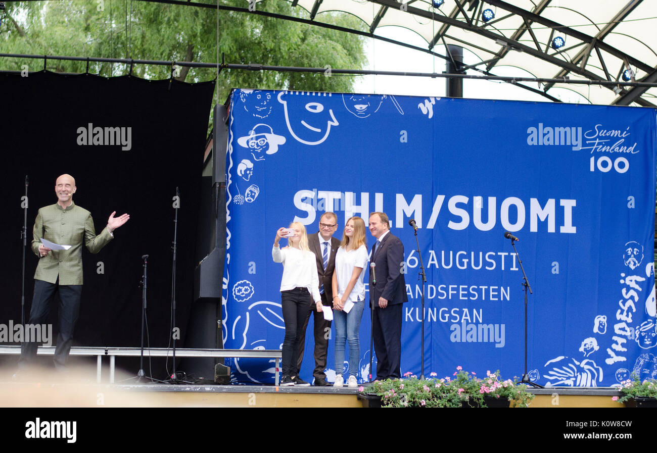 Stockholm, Sweden - August 25 2017. The Prime ministers of both Sweden and Finland visiting the 3-day festival to celebrate Finlands 100-year anniversary in Kungsträdgården in the central part of Stockholm. After talking with the media-personality Mark Levengood on stage, two students from finnish schools in Sweden, who also asked questions to the Prime ministers, end with asking for a selfie with them. Credit: Jari Juntunen/Alamy Live News - Stock Image