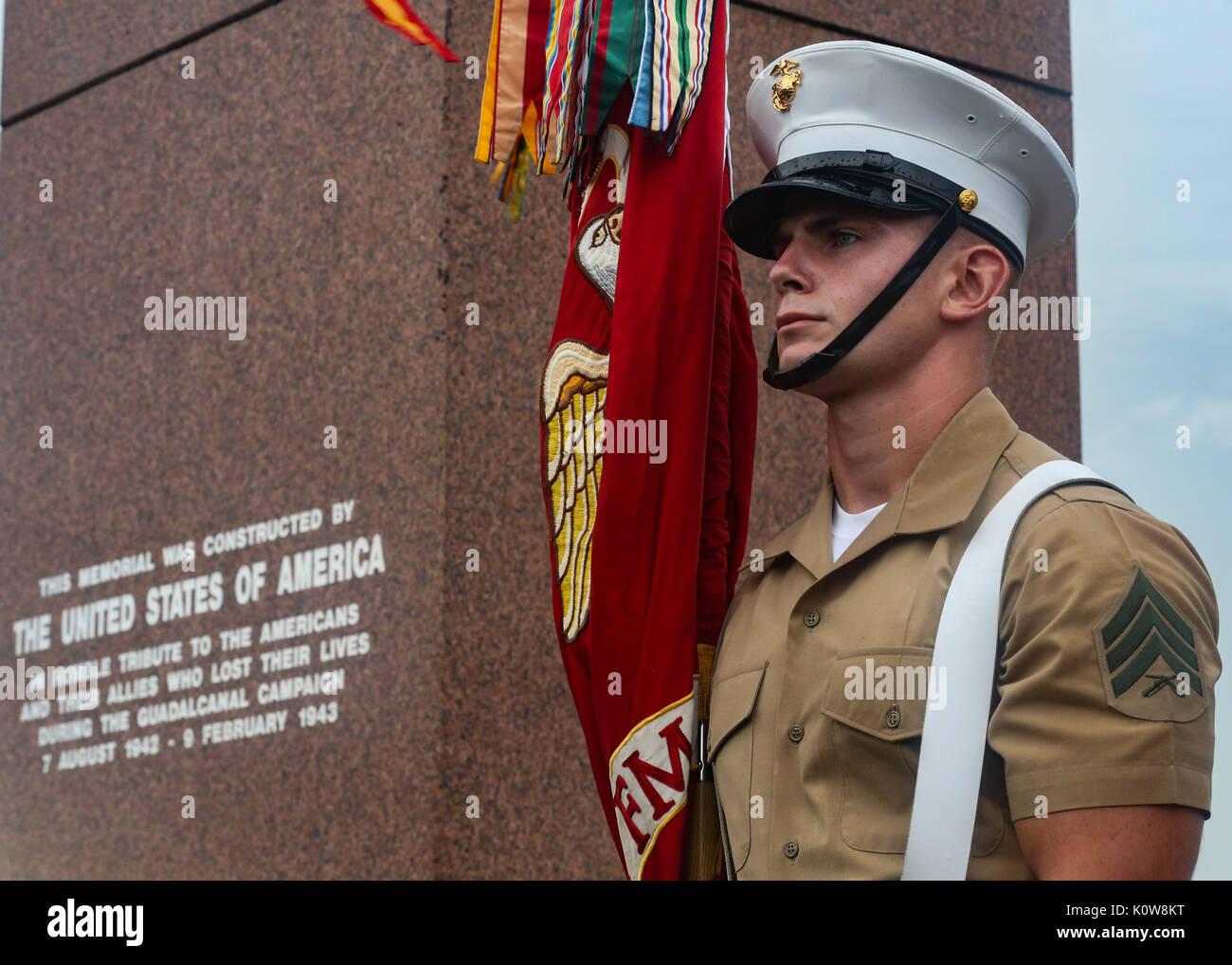 U.S. Marine Corps Sgt. Jeremy Pogue, a rifleman with 1st Battalion, 1st Marine Regiment, 1st Marine Division, stands Stock Photo