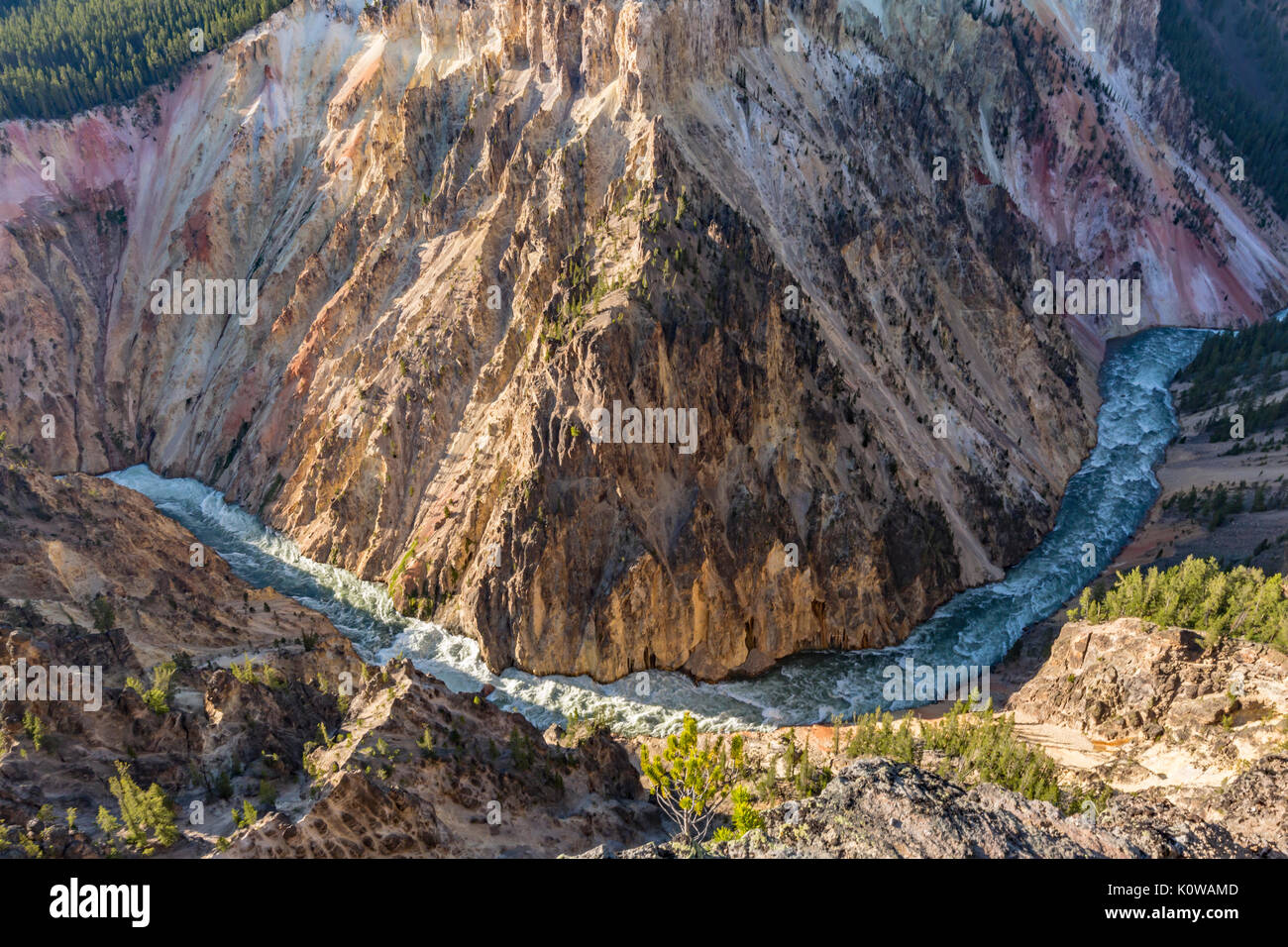 A wide, sweeping turn of the raging Yellowstone River below Inspiration Point in Yellowstone National Park, Wyoming - Stock Image
