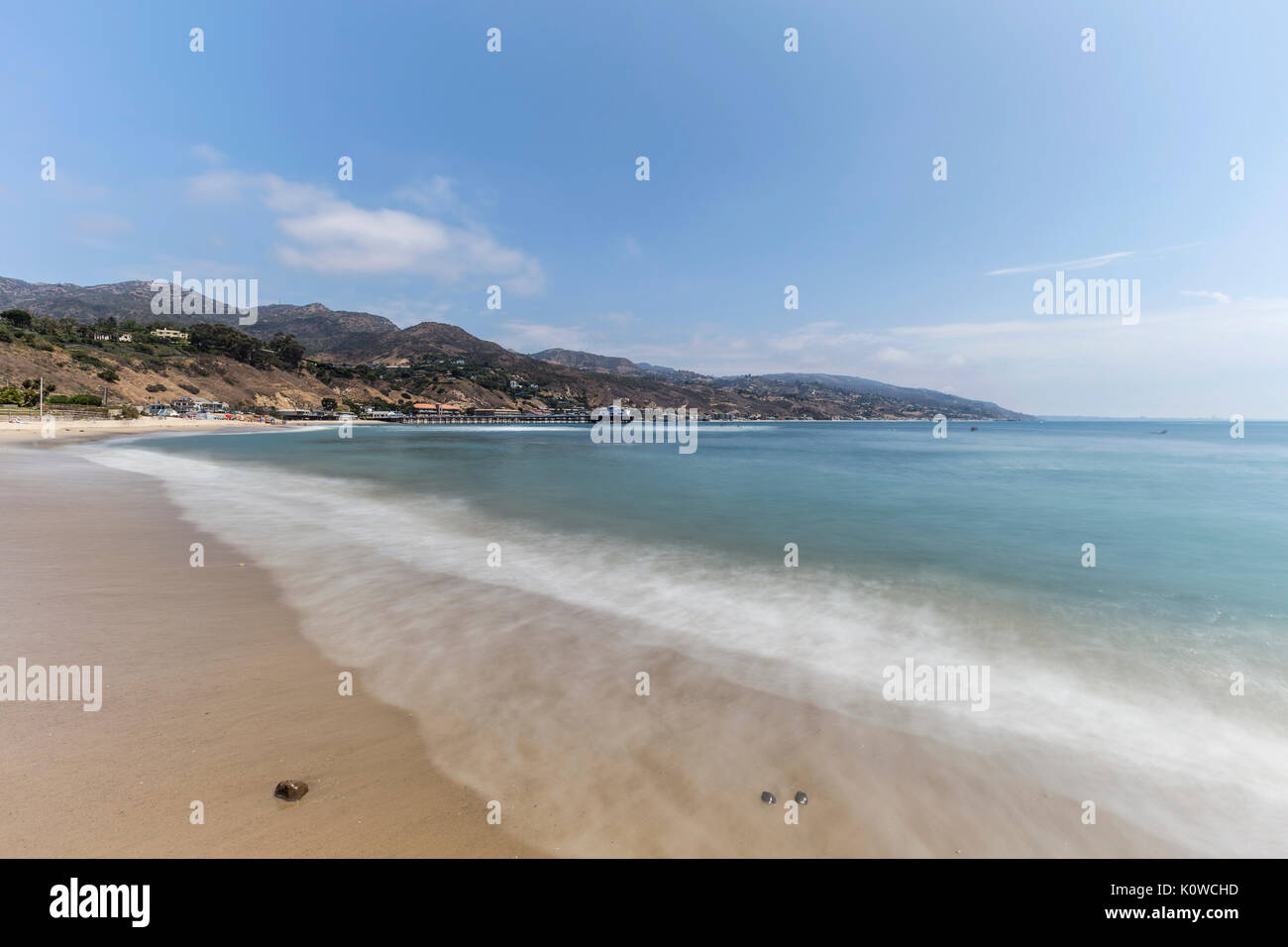 Malibu beach with motion blur surf near Los Angeles in Southern California. - Stock Image