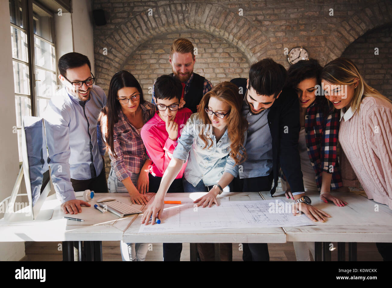 Portrait of young perspective designers having meeting - Stock Image