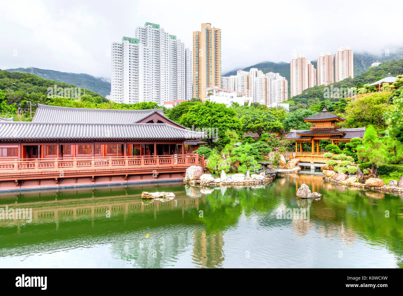 Blue Pond and Pavilion Bridge at Nan Lian Garden, a Chinese Classical Garden in Diamond Hill, Kowloon, Hong Kong. The public park has an area of 3.5 h - Stock Image