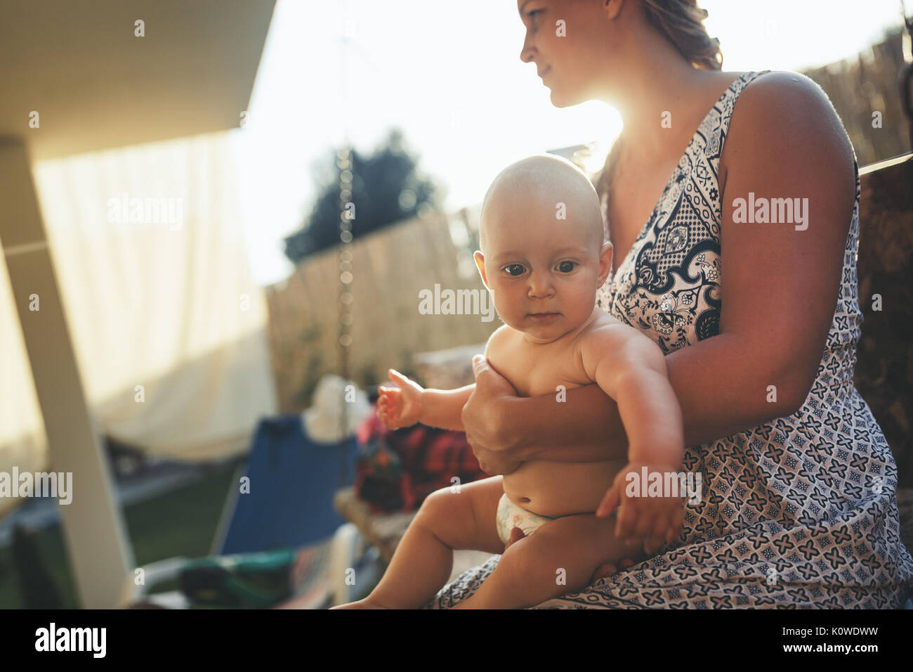 Portrait of happy mother holding her baby - Stock Image