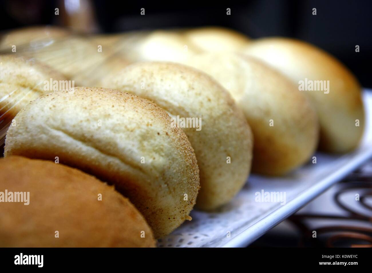 Photo of dinner rolls on a tray - Stock Image