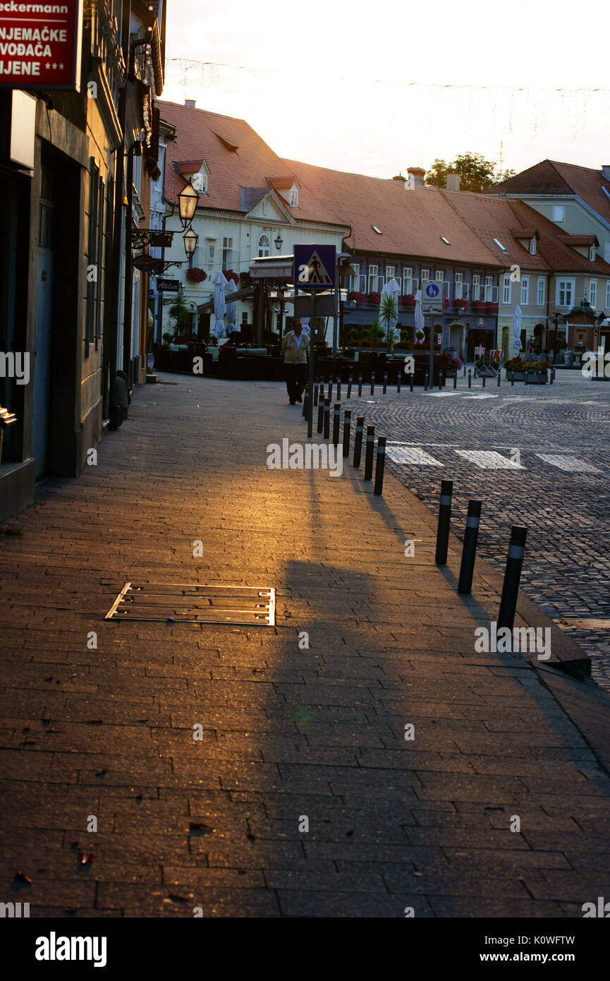 Main square in Samobor with a sunrise appearing on it - Stock Image