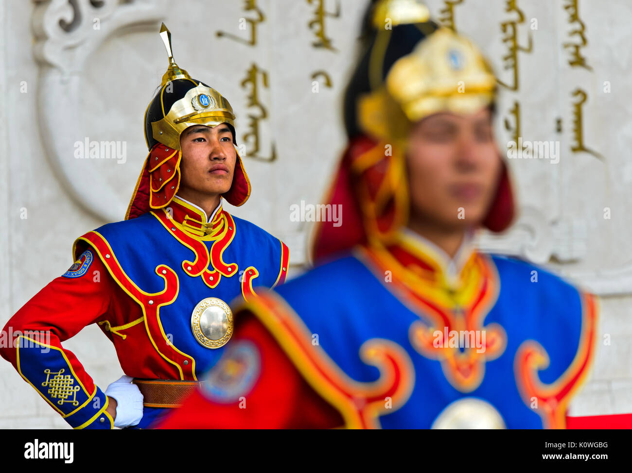 Guardsman of the Mongolian Armed Forces Honorary Guard in traditional uniform in front of the monument to Genghis Khan, Ulaanbaatar, Mongolia - Stock Image
