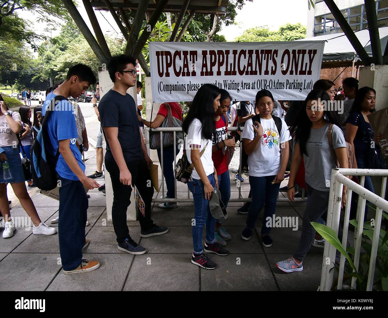 QUEZON CITY, PHILIPPINES - AUGUST 16, 2017: Students line up to submit their application form for the college entrance Stock Photo
