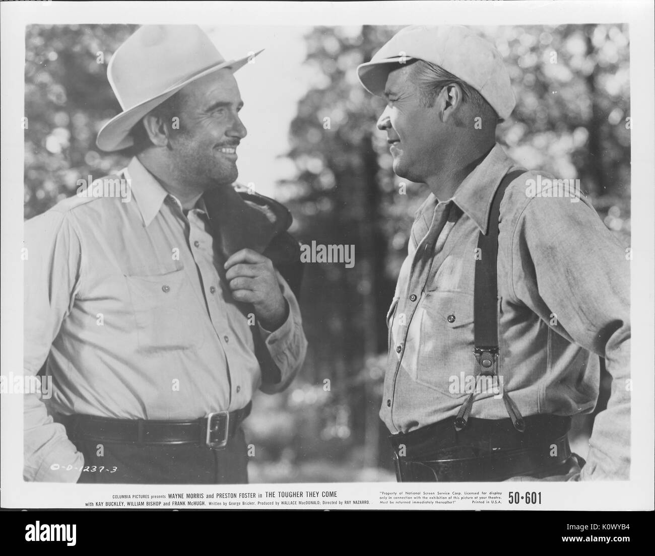 Wayne Morris and Preston Foster in overalls and cowboy hats in a film still from The Tougher They Come, 1935. Photo credit Smith Collection/Gado/Getty Images. - Stock Image