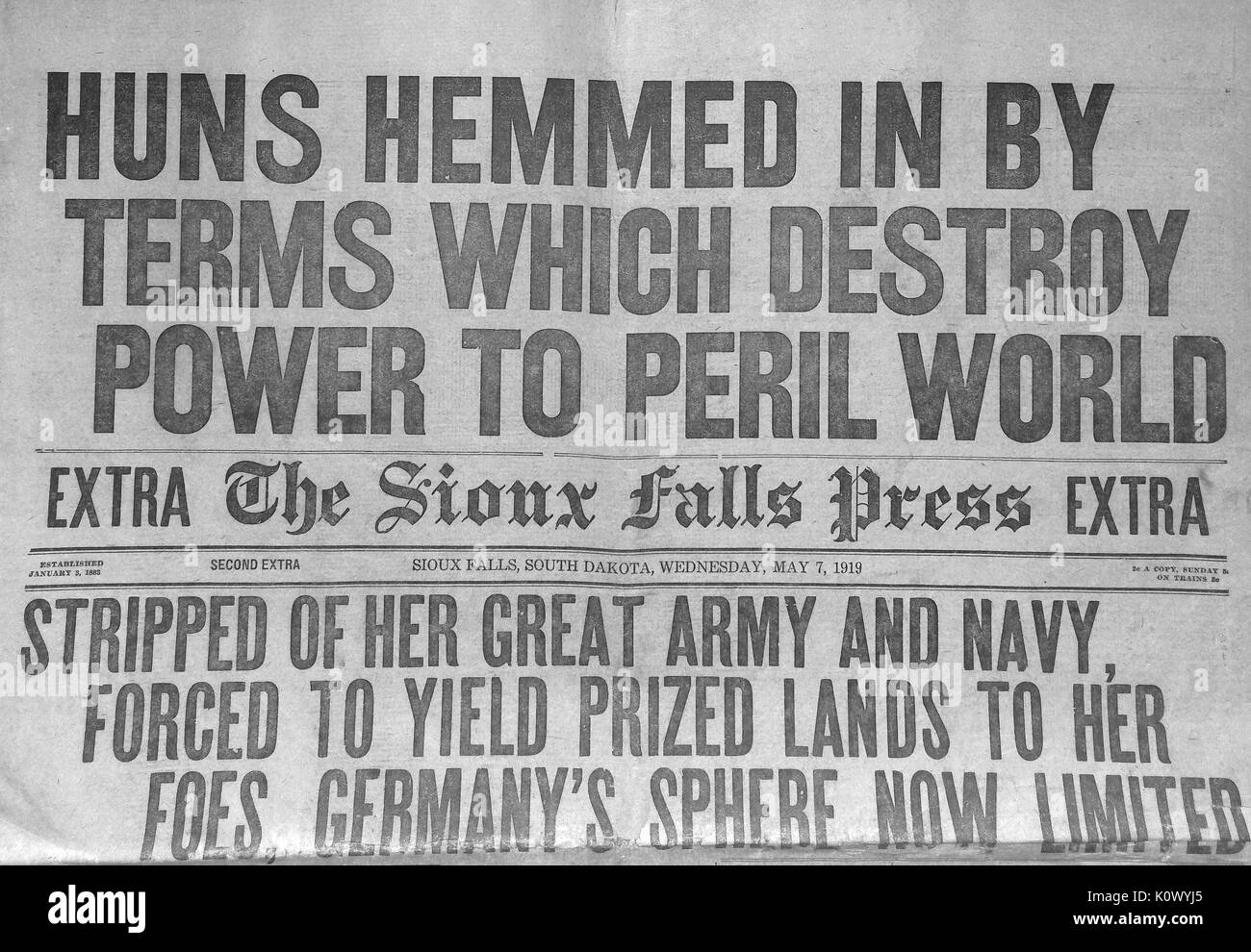 Huns Hemmed in By Terms Which Destroy Power to Peril World, newspaper front page headline for the Sioux Falls Press announcing the surrender of Germany during World War 1, headline continues Stripped of her great army and navy, forced to yield prized lands to her foes, Germanys sphere now limited, 1918. Photo credit Smith Collection/Gado/Getty Images. - Stock Image
