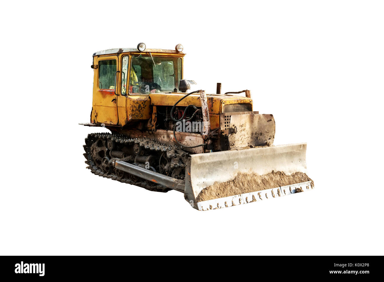 Vintage excavator working on clearing the land isolate on white background. - Stock Image