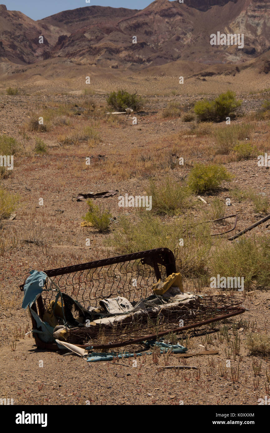 A destroyed sofa decaying in the middle of the Nevada Desert - Stock Image