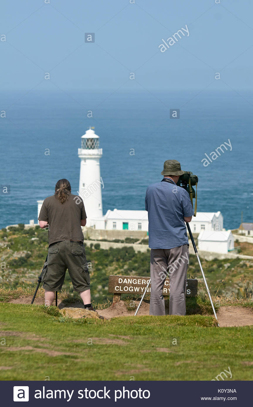 Two adult males with scopes birdwatching on South Stack in Anglesey North Wales UK - Stock Image