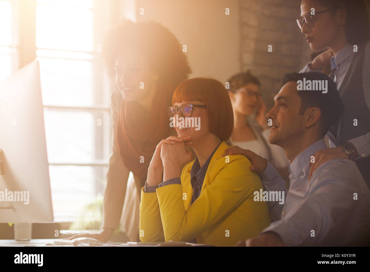 Young working group with manager on briefing in office - Stock Image