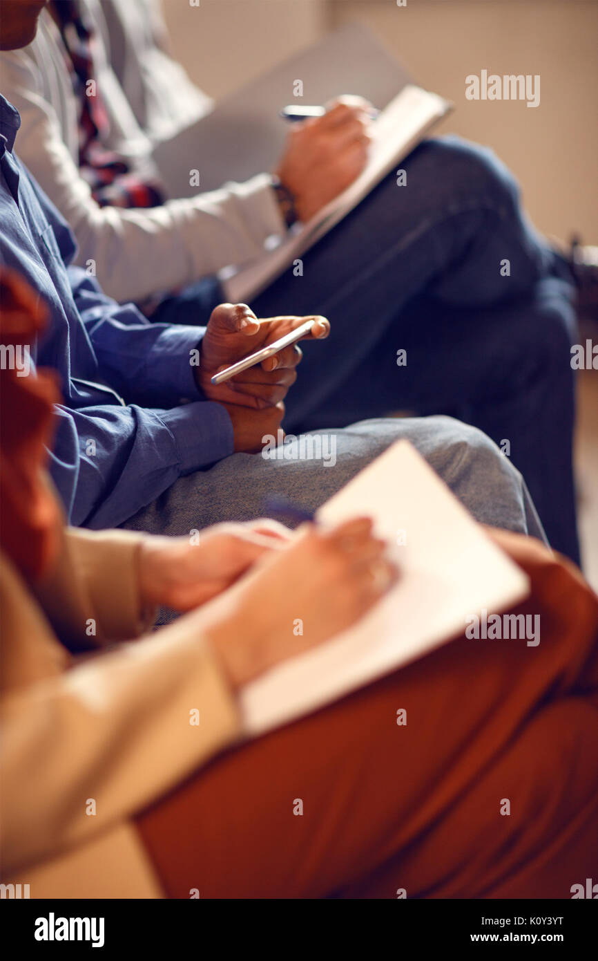 Close up of writing notes on business meeting, concept - Stock Image