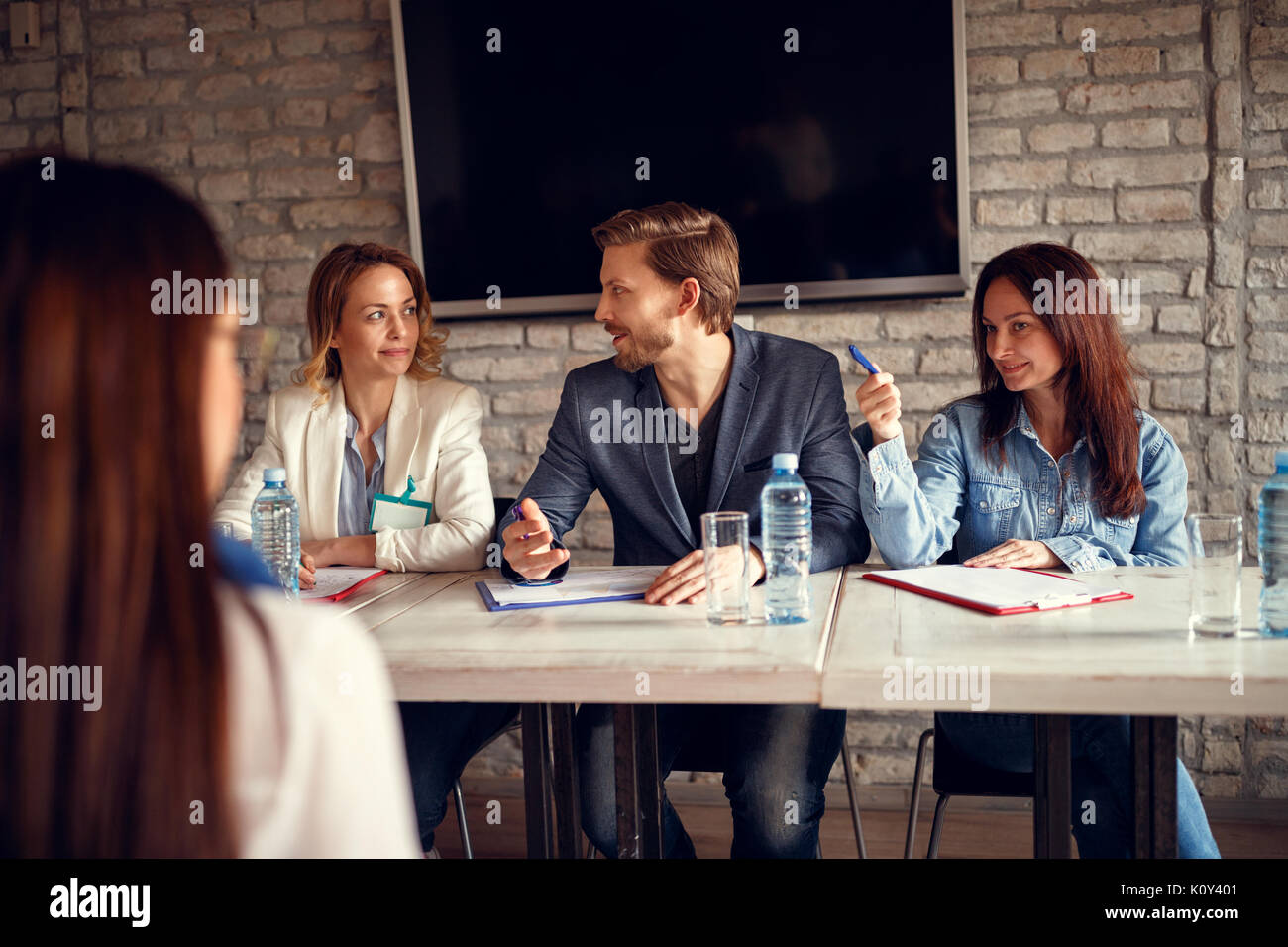 Discussion business people for job interview with candidate on meeting - Stock Image