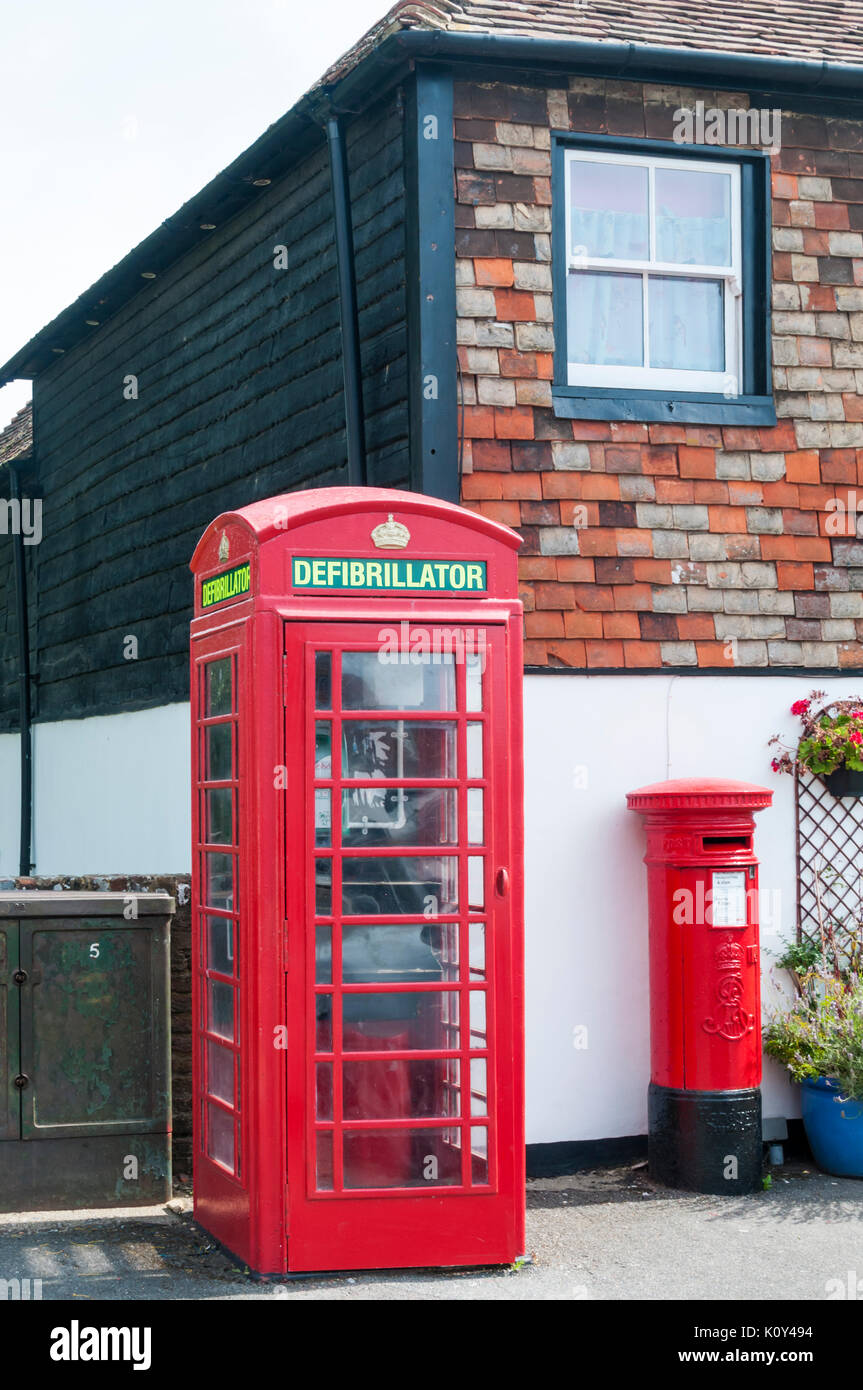 Public defribillator sited in an unused telephone box at Lydd in Kent. - Stock Image