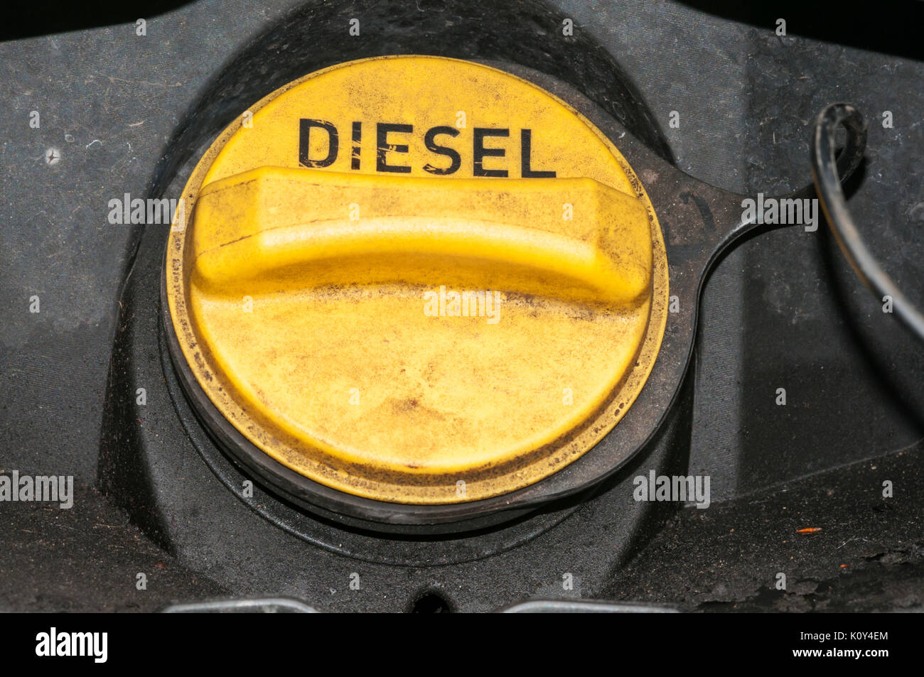 The messy filler cap of a diesel fuelled Land Rover.  See K25X3F for black & white version. - Stock Image