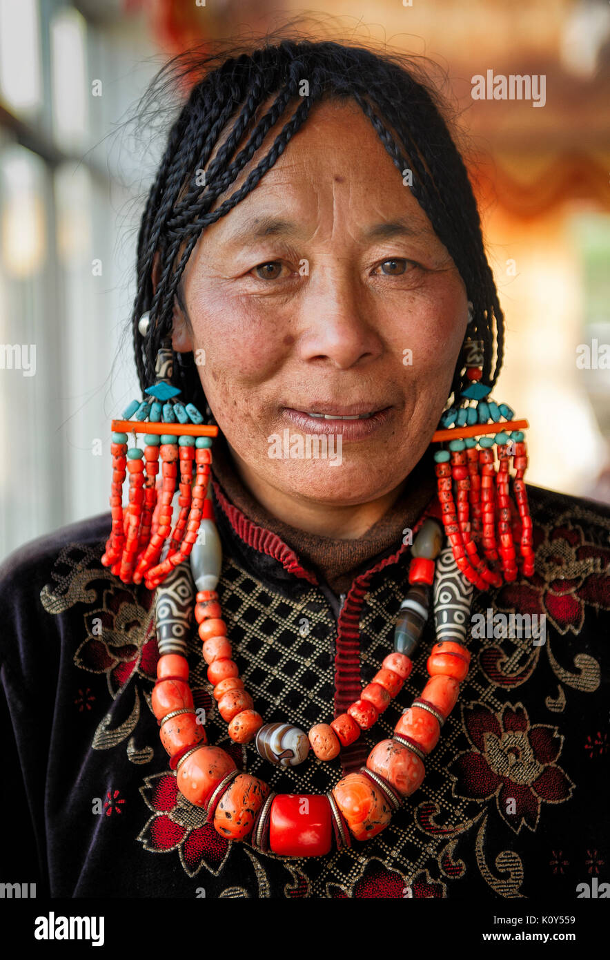 A bride's mother at the reception before the wedding. Tibetan plateau - Stock Image