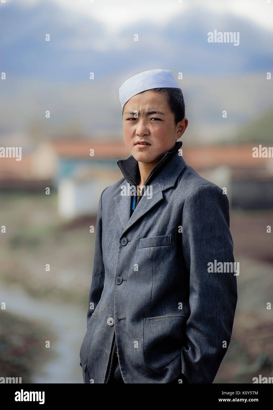 A teenager from the Hui ethnic minority of China. - Stock Image