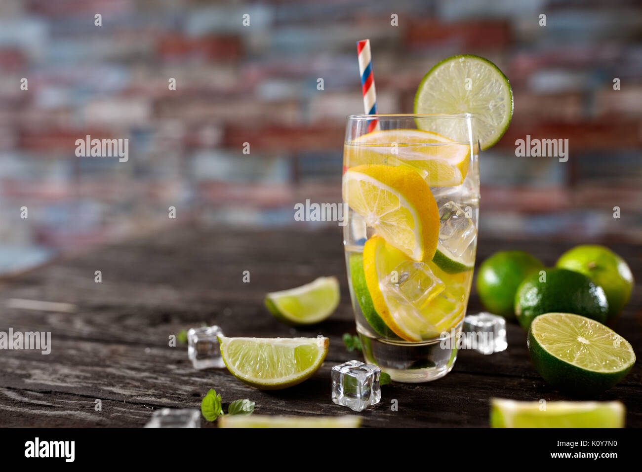Citrus fruit fresh summer cocktail with water dieting in glass- healthy lifestyle concept - Stock Image