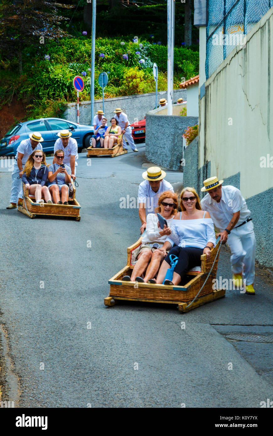 Toboggan ride going down in Monte. - Stock Image
