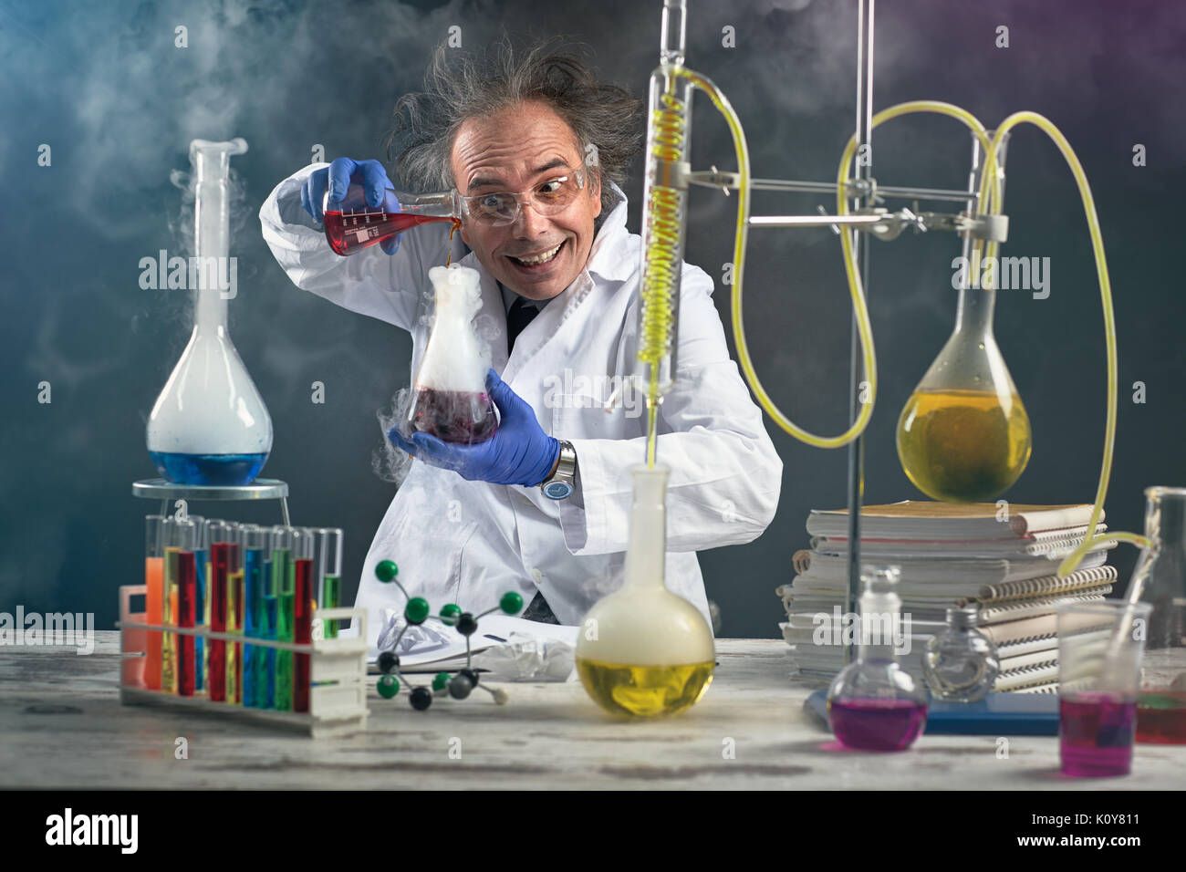 crazy-chemist-doing-experiment-chemical-laboratory-K0Y811.jpg