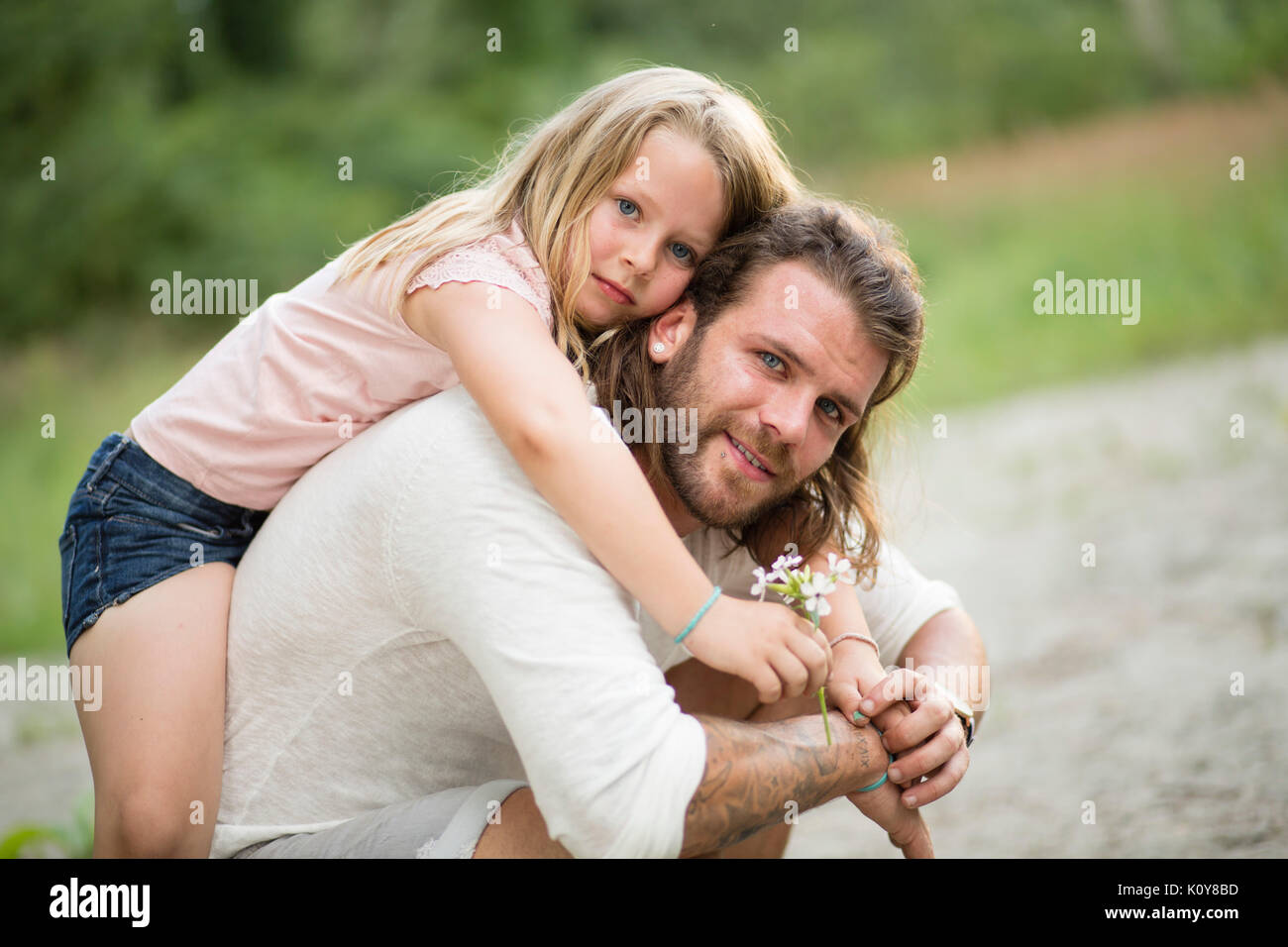 Father and daughter together in the forest - Stock Image