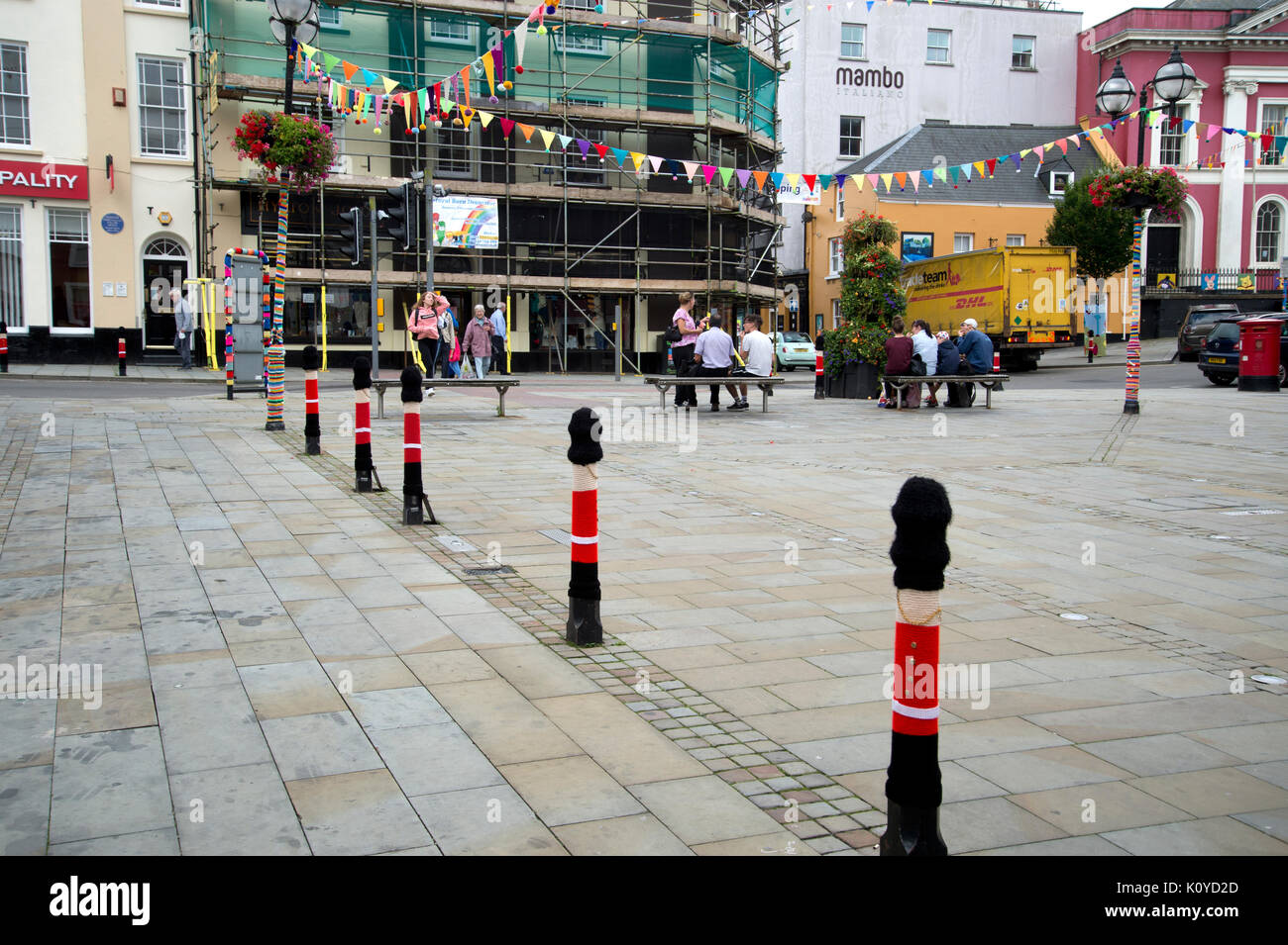 West Wales. Haverford West. Breaking Out the Gallery .... outdoor art, part of town regeneration and celebration. Knitted guardsmen covers for street  - Stock Image