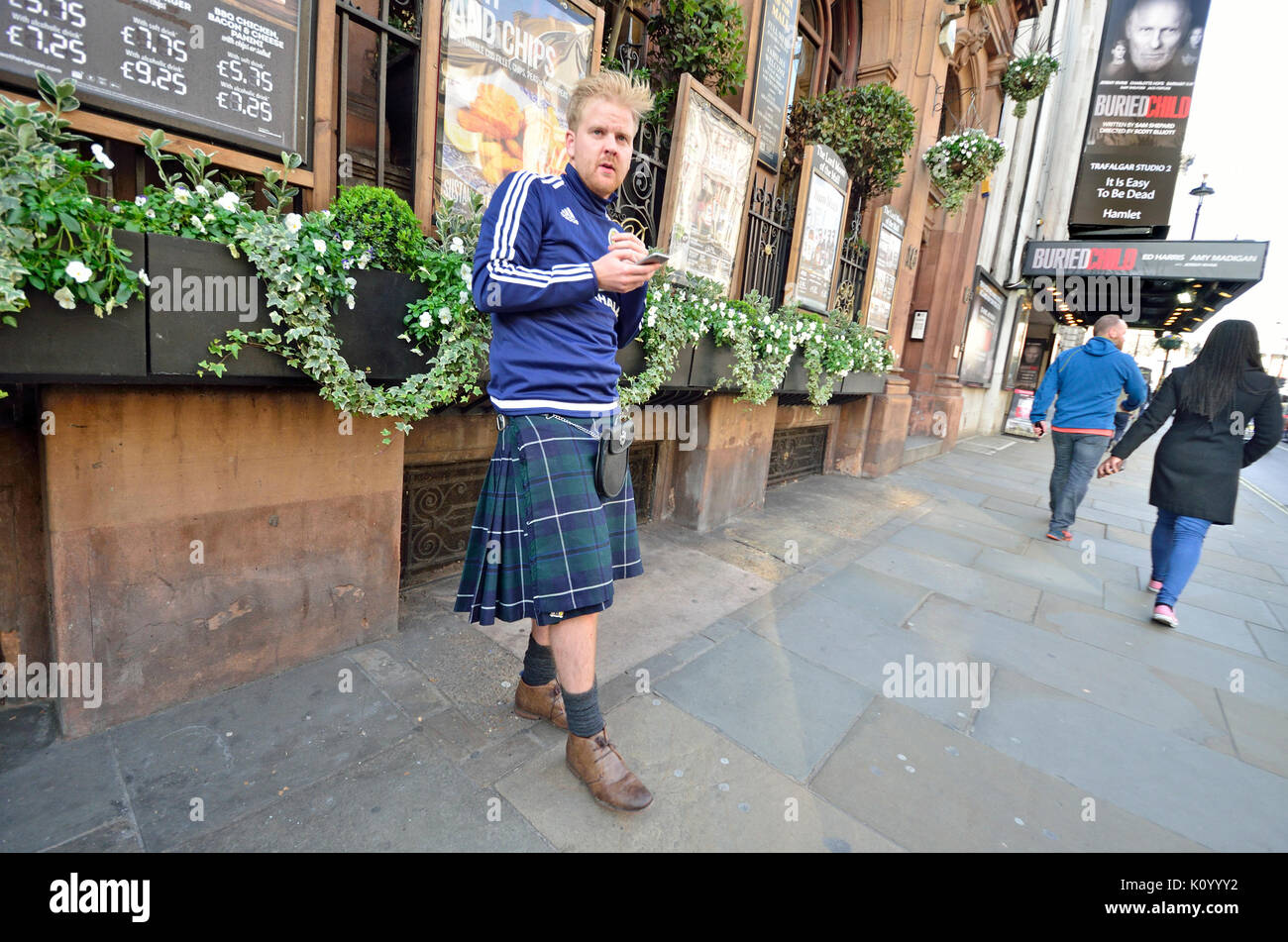 London, England, UK. Man wearing a kilt in Whitehall - Stock Image
