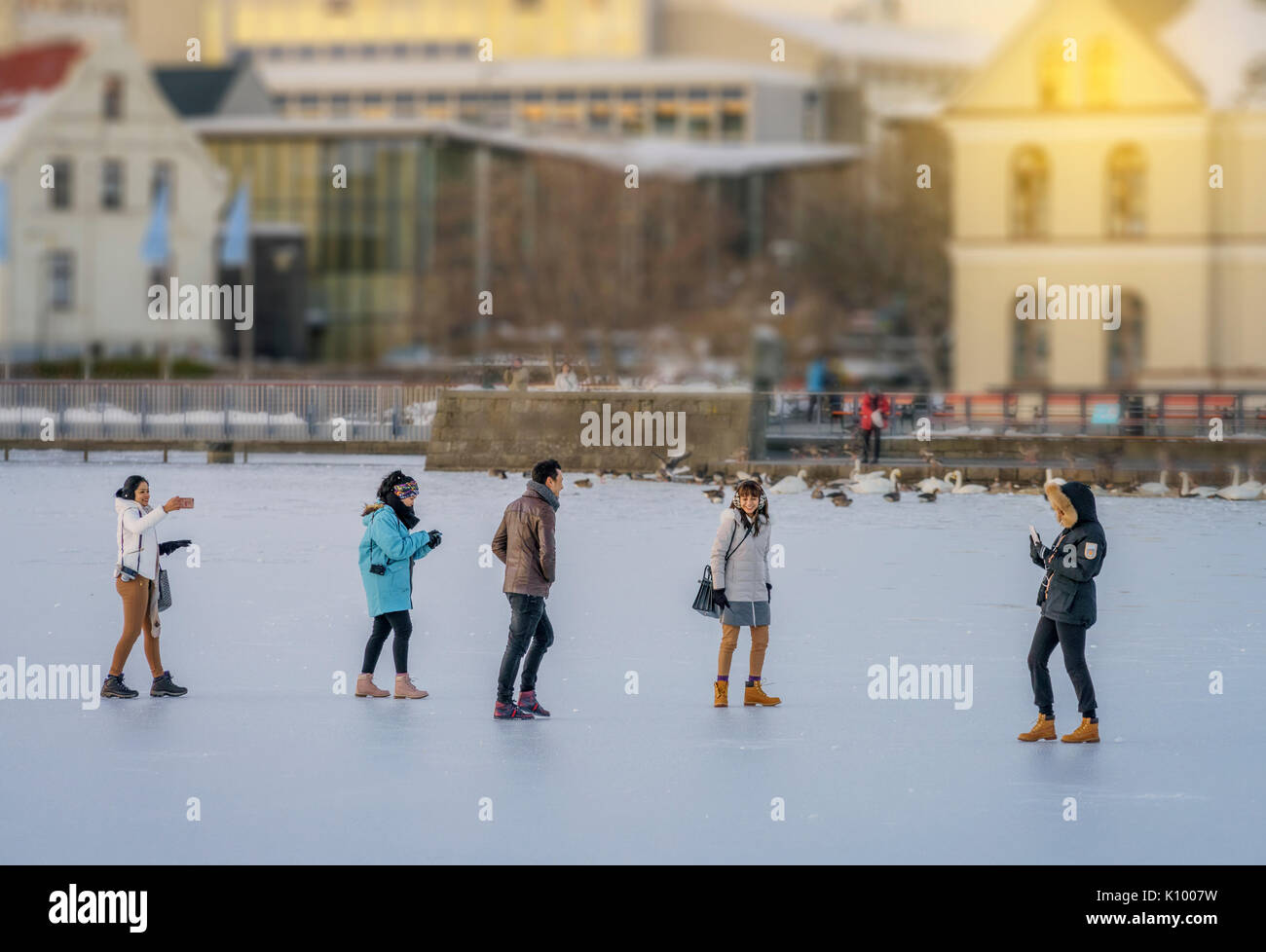 People walking on the frozen pond in Reykjavik, Iceland Stock Photo