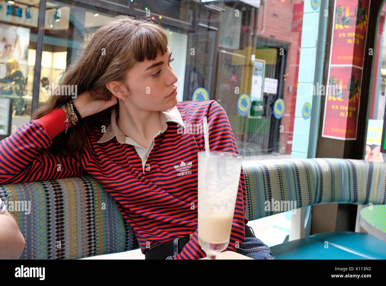 young teenage female in cafe - Stock Image