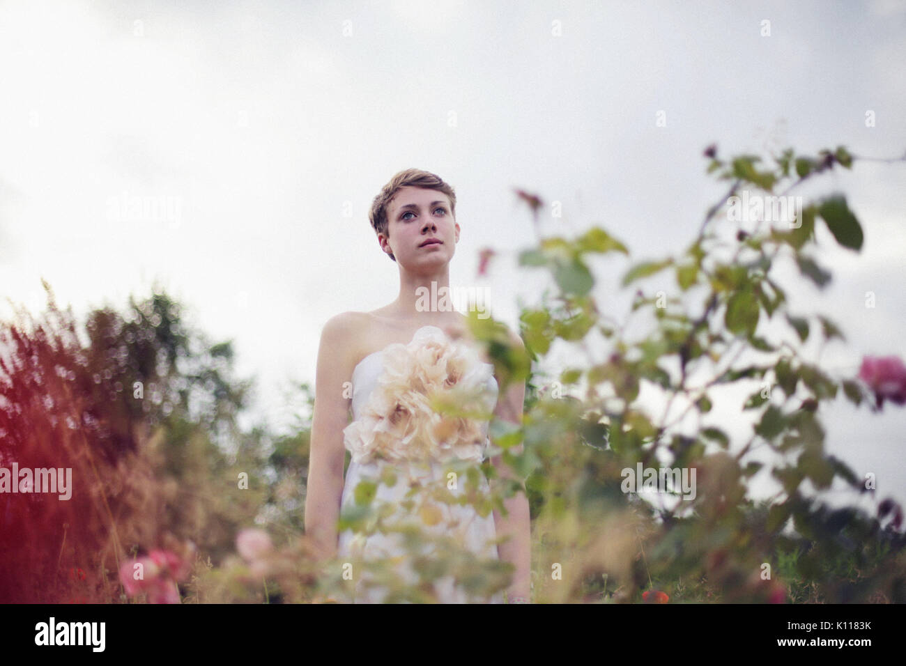 Young woman in a garden - Stock Image