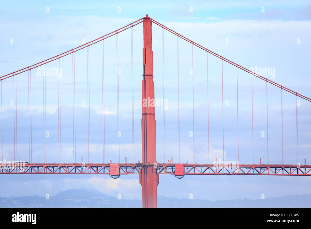 Golden Gate Bridge suspension tower and blue sky - Stock Image