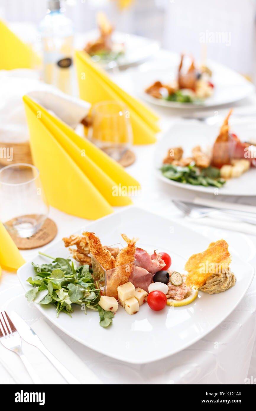 Finest restaurant dinner table with fine dining appetizer - Stock Image