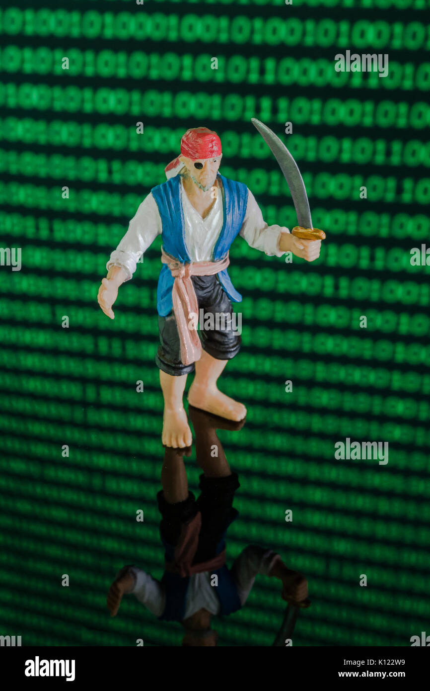 Sword-wielding pirate & wall of binary zeros and ones - for malware, software & data piracy, copyright, technology & intellectual property / IP theft - Stock Image