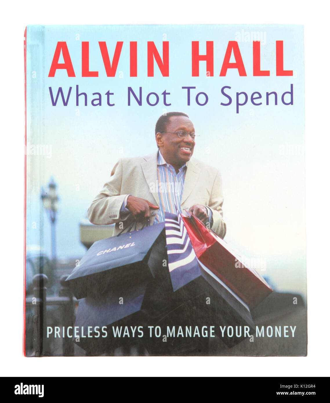 The book What Not to Spend by Alvin Hall - Stock Image