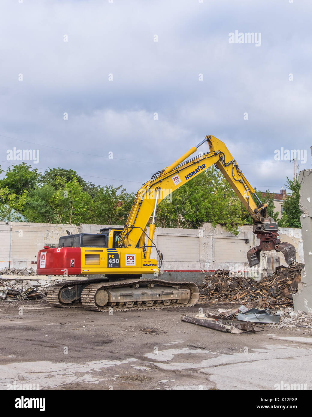 Heavy equipment demolishes an old building in downtown Orillia Ontario to make way for new condominiums. - Stock Image