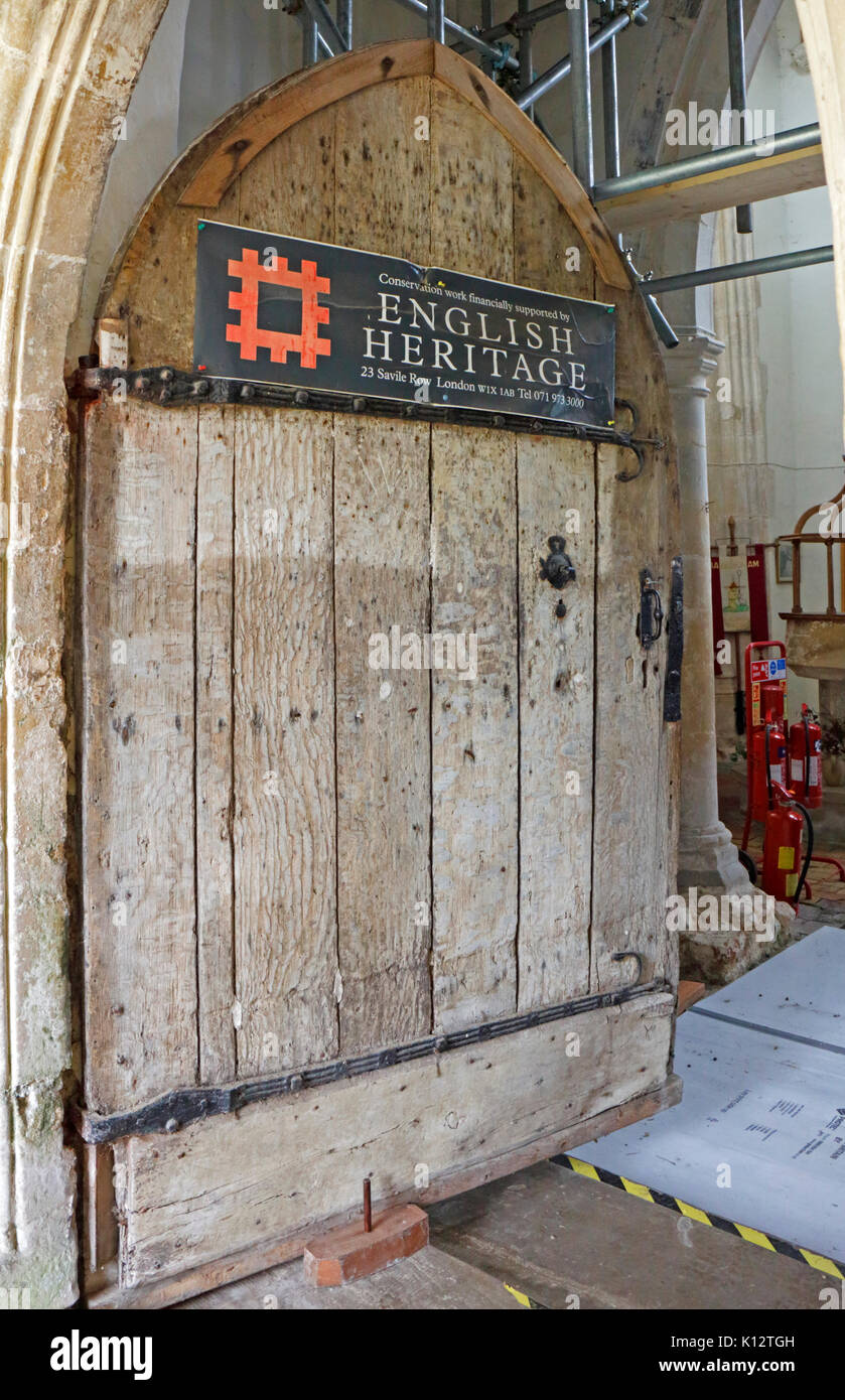 An English Heritage sign relating to restoration work at the parish church of St Botolph at Banningham, Norfolk, England, United Kingdom. - Stock Image