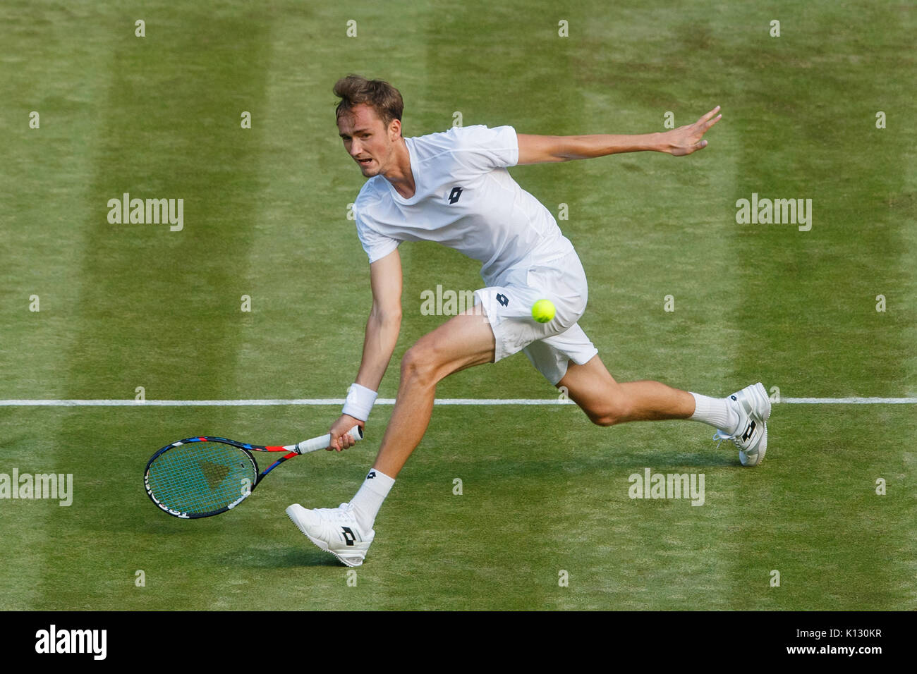 Daniil Medvedev in action against Stan Warwrinka at the Gentlemen's Singles 1st Round - Wimbledon Championships 2017 - Stock Image
