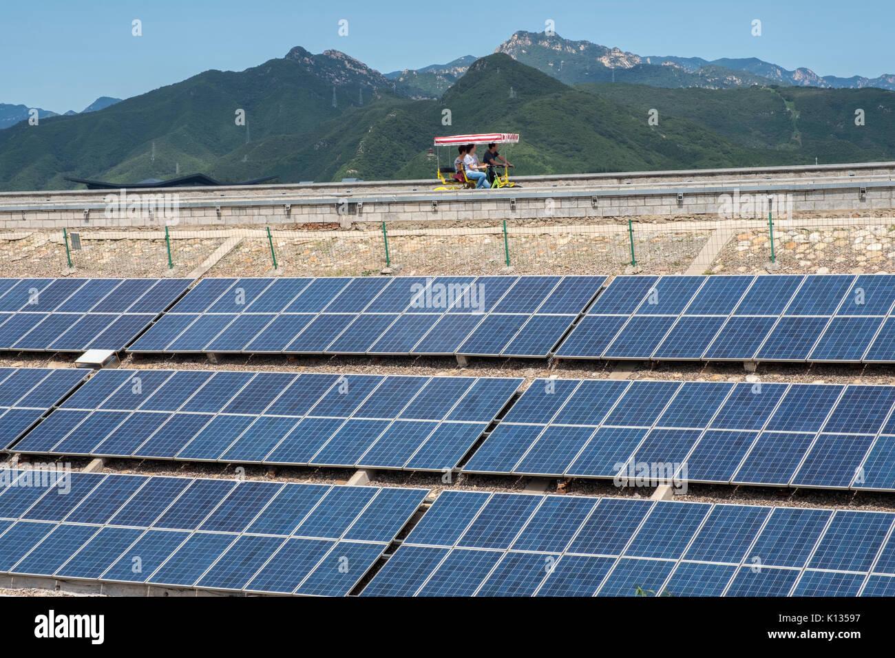Photovoltaic solar panels on the dam of Yanqi Lake in Huairou, Beijing, China. 24-Aug-2017 - Stock Image