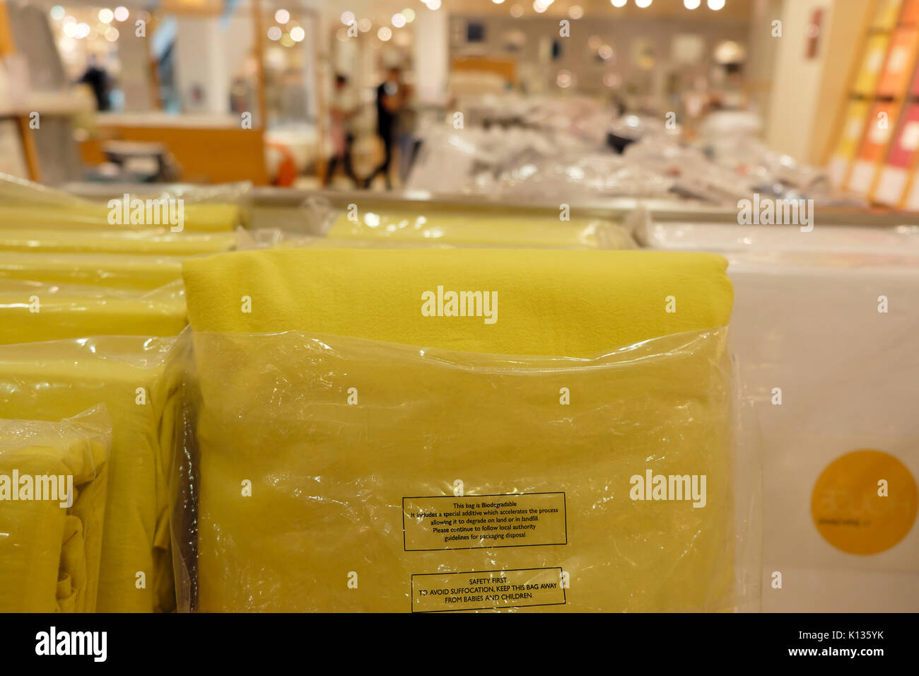 Biodegradable packaging sign destined for landfill on flannelette duvet covers displayed in department store bed linen area UK  KATHY DEWITT - Stock Image