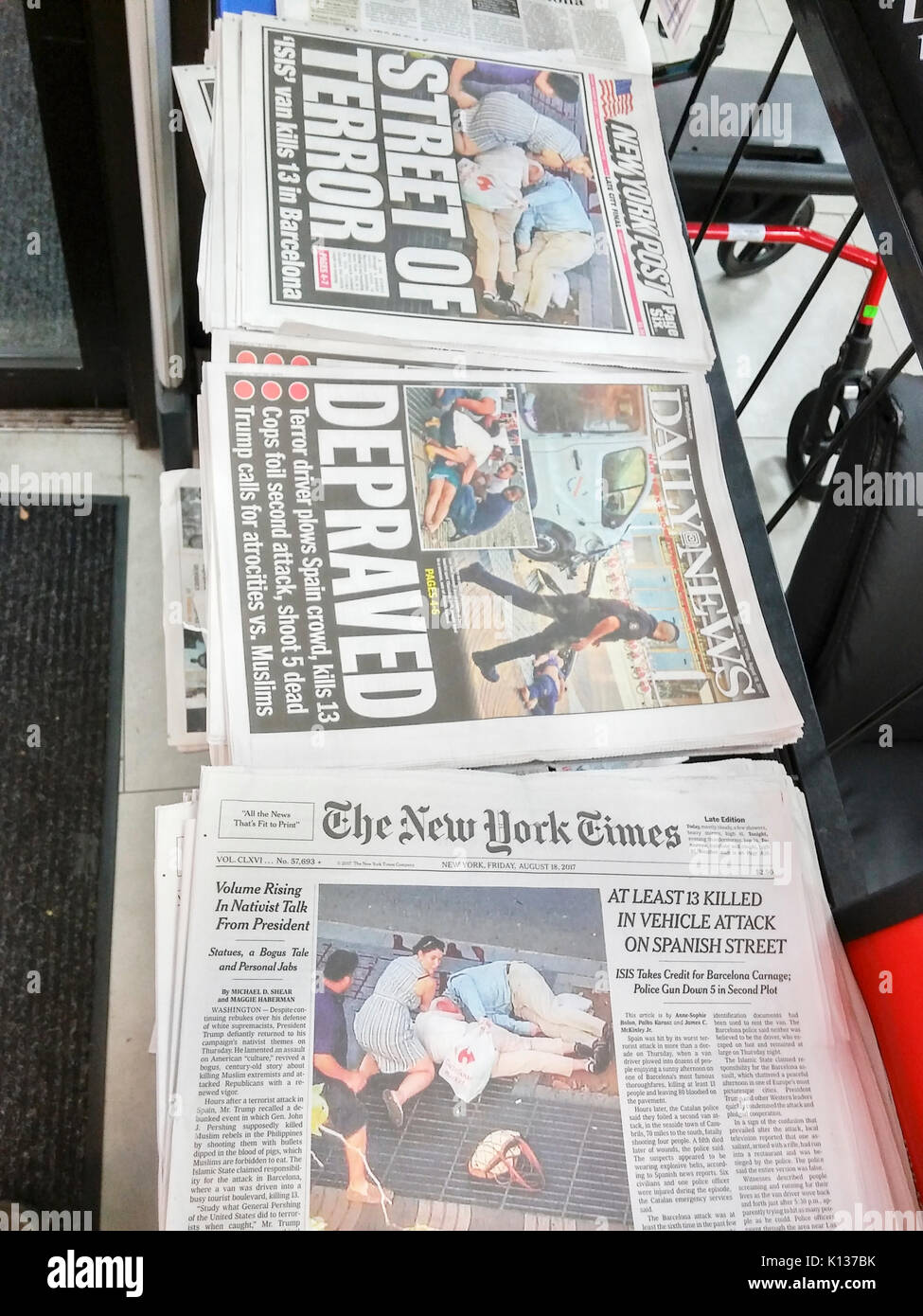 New York newspapers on Friday, August 18, 2017 report on the previous night's terrorist attack in Barcelona, Spain which left 13 dead and over 100 injured. (© Richard B. Levine) Stock Photo