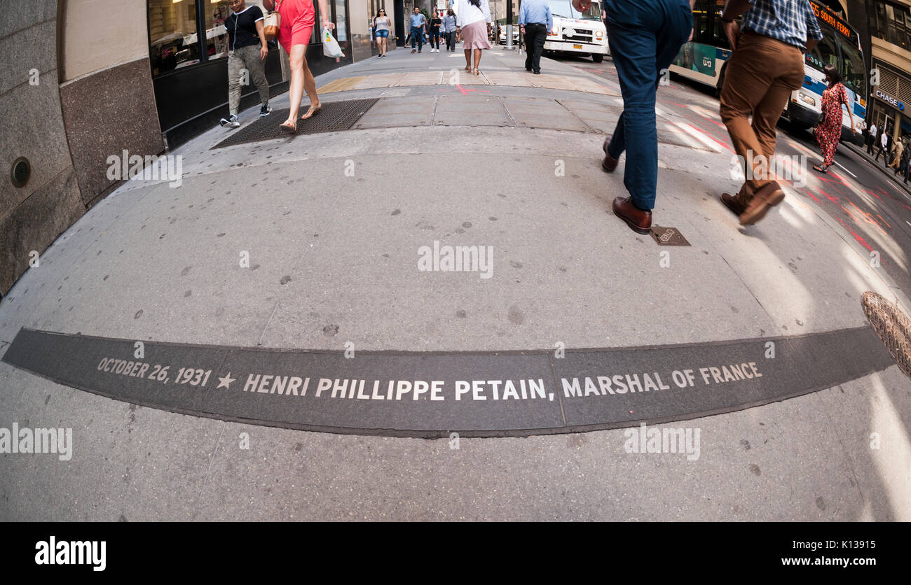 A plaque commemorating French Field Marshal Philippe Pétain embedded in the Canyon Of Heroes in Lower Manhattan in New York on Thursday, August 17, 2017. The plaque was installed in 2004 to commemorate the 1931 ticker-tape parade that honored Pétain for his World War I valor. However, Pétain went on to head the Vichy government in occupied France during World War II and was responsible to the murder of over 10,000 Jews by the Germans in concentration camps. In the wake of the Charlottesville murder Mayor De Blasio has ordered the city to remove 'monuments and markers that glorify bigotry and s - Stock Image