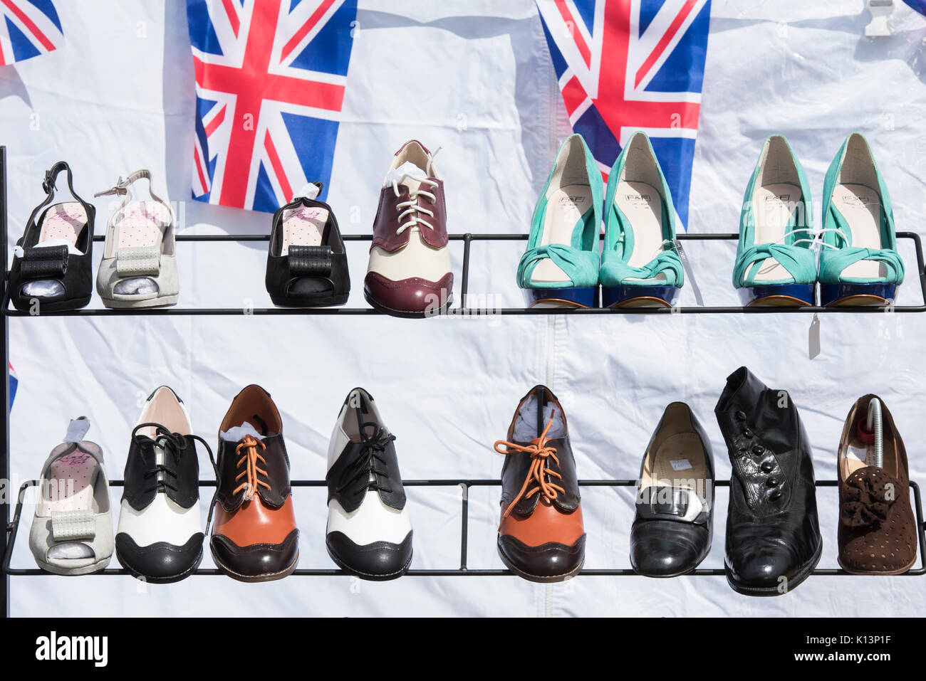 Vintage style mens and ladies shoes for sale on a stand at a vintage retro festival. UK - Stock Image