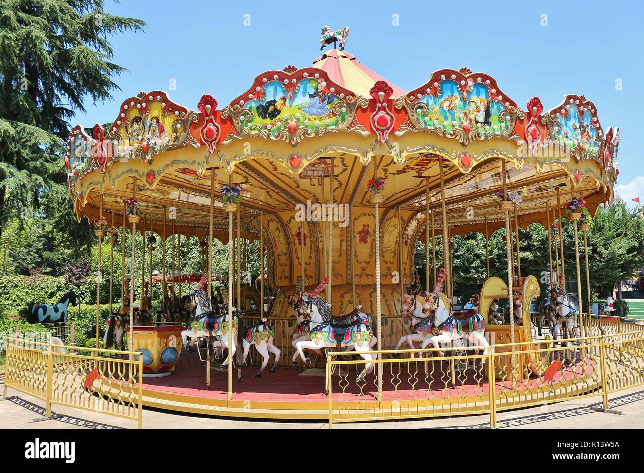 Nostalgic children's carousel in a fun park in the center of Tirana, Albania. Southeast Europe. - Stock Image