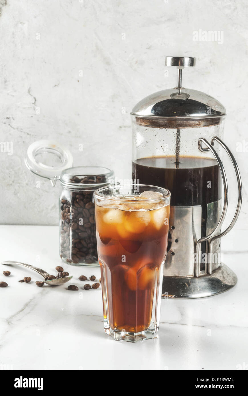 Trendy drinks. Cold brew iced coffee on white marble table. copy space - Stock Image