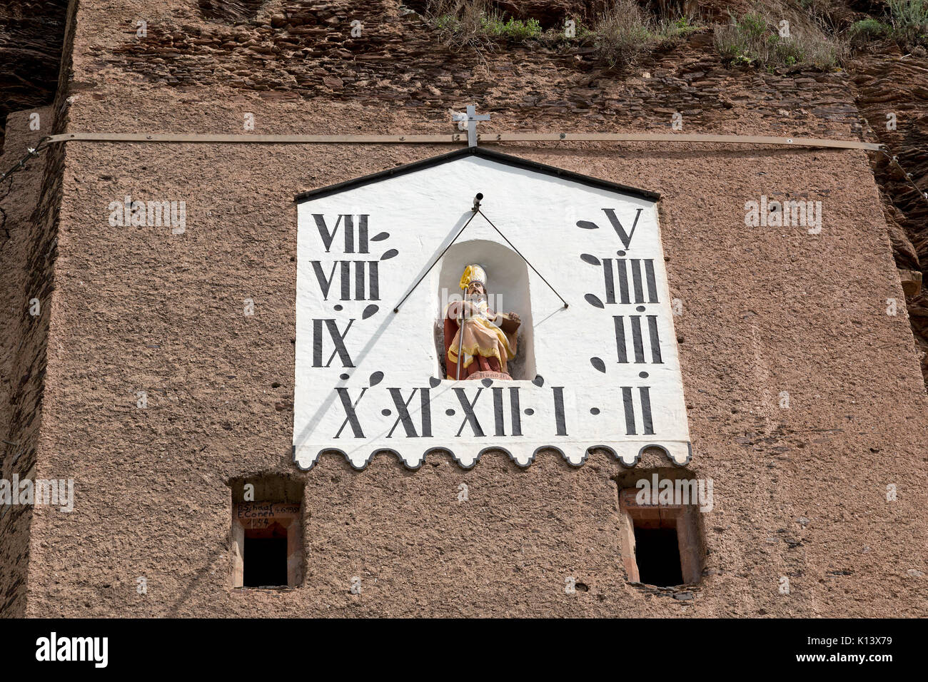 sun dial in the cliffs near Uerzig, Moselle, Rhineland-Palatinate, Germany - Stock Image