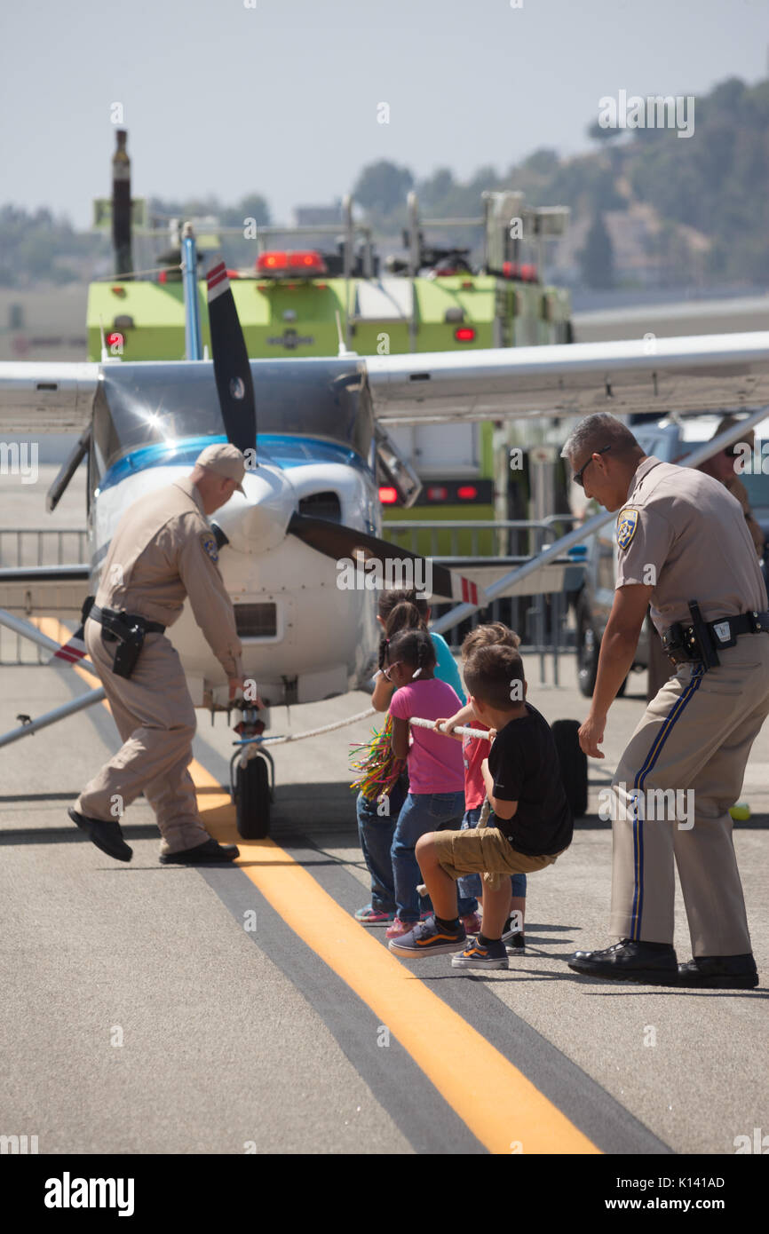 August 19, 2017 - Children have a plane pull of their own supervised by the California Highway Patrol at the Special Olympics Southern California Plan - Stock Image